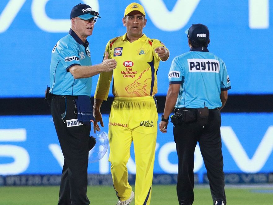 Ms Dhoni with umpires